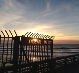 Ocean-Beach-fence-with-sunset-poking-thru-1024x477